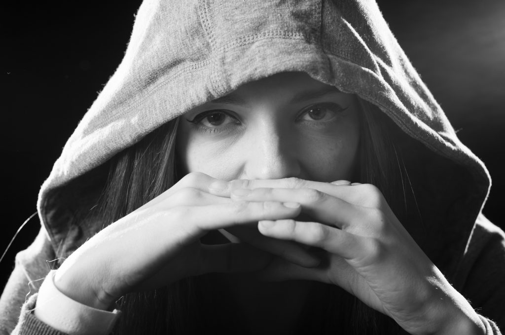 teenager girl posing cool showing attitude wearing hood on